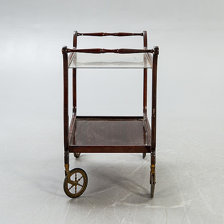 A mid 1900s mahogany serving trolley.