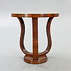 An art deco walnut side table later part of the 20th century.