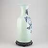 A large chinese blue and white vase, qing dynasty, around the year 1900.