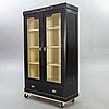 A painted early 1900s display cabinet.