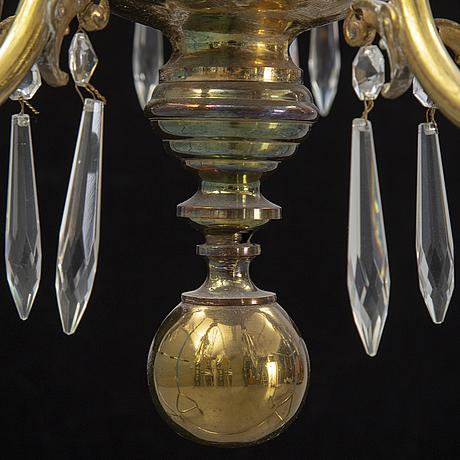 A brass chandelair, around the year 1900.
