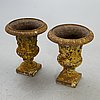 A pair of cast iron garden urns fist half of the 20th century.