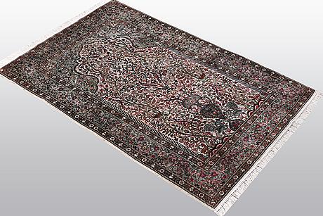 A rug, qum silk, ca 124 x 77 cm.