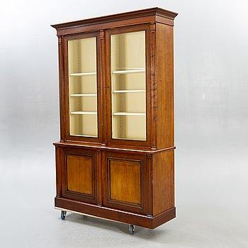 A modern mahogany display cabinet.