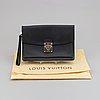 Louis vuitton, a black taiga pochette, 2008.
