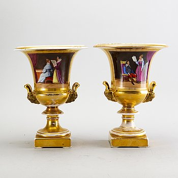 A pair of late Empire porcelain urns, mid 1800s.