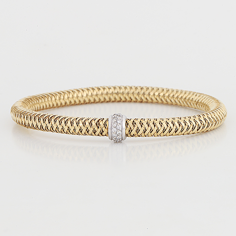 18k gold bracelet, with brilliant-cut diamonds and ruby.