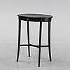 A 20th century painted side table.