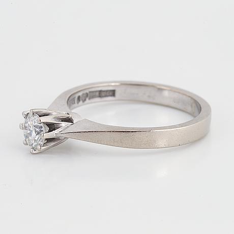 Brilliant-cut diamond solitaire ring.