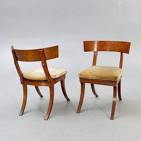 A set of four mahogany chairs around 1900.