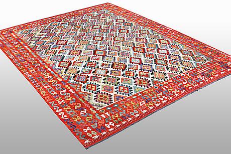 A carpet, kilim, ca 395 x 305 cm.