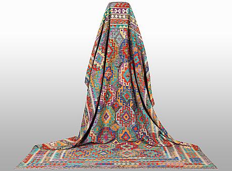 A carpet, kilim, ca 392 x 294 cm.