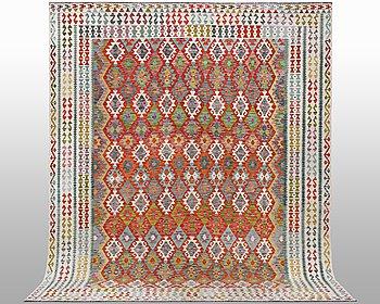 A carpet, kilim, ca 391 x 308 cm.