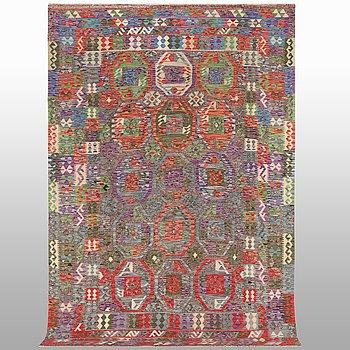 A carpet, kilim, ca 328 x 202 cm.