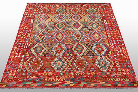 A carpet, kilim, ca 297 x 202 cm.