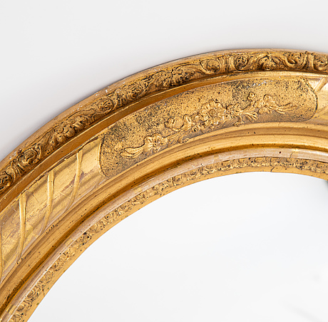 An oval mirror from around the year 1900.