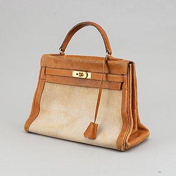 Hermès, a leather and canvas 'Kelly 32' handbag, 1959.
