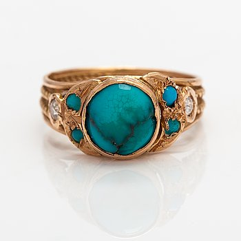 An 18K gold ring with turquoises and diamonds ca. 008 ct in total.