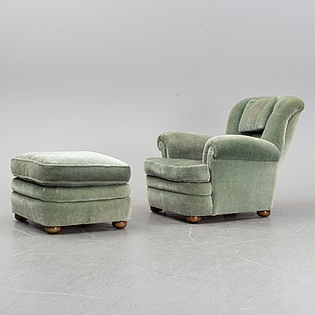 A model 336 lounge chair with foot stool by Josef Frank for Firma Svenskt Tenn, designed in 1934.