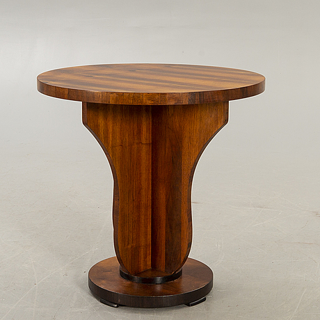 An art deco style walnut table later part of the 20th century.