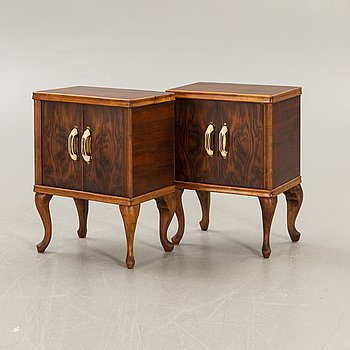 A pair of walnut bedside tables second half of the 20th century.
