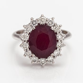 An 18K white gold ring with a ca. 4.98 ct ruby and diamonds ca. 0.90 ct in total according to certificate.