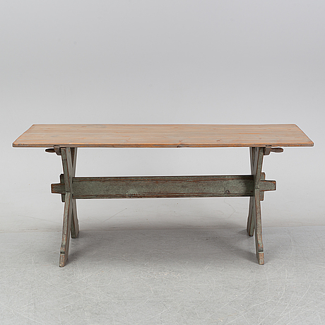 A 19th century painted pine table.