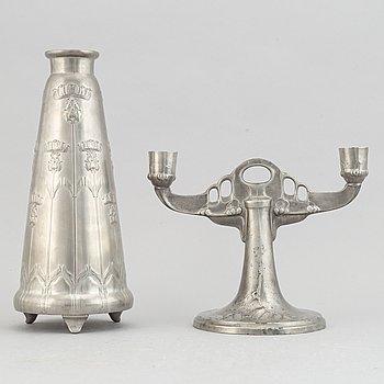 A Kayserzinn pewter vase and candelabrum, German, early 20th Century.