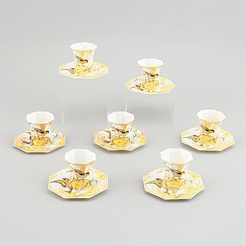 Rozenburg den Haag, seven egg shell porcelain cups and saucers, Holland, early 20th Cnntury.