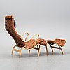 A 'pernilla 2' easy chair with stool by bruno mathsson for firma karl mathsson dated 1964 & -65.