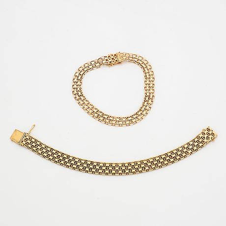 Two 18k gold bracelets.