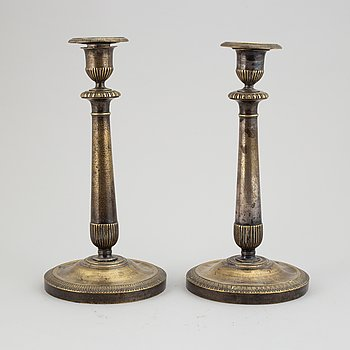 A pair of empire argent haché candlesticks, first half of the 19th century.