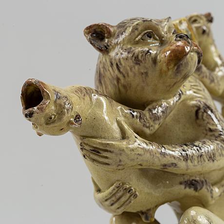 A stoneware monkey jug, signed n. schmidt eneret.