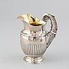 A silver creamer by johan petter ahlforss, strängnäs, 1833 and a silver sugar box, kristianstad, 1928.