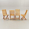 A set of four chairs and a table royal teak and others, later part of the 20th century.