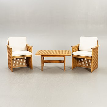 A pair of armchairs and a table Kircodan later part of the 20th century.