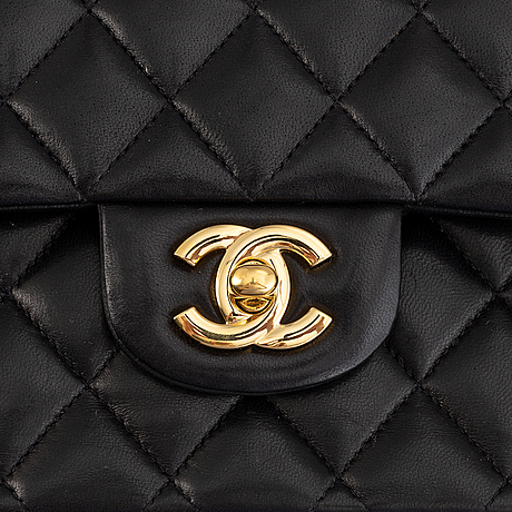 Chanel, a black, quilted leather 'double flap' bag, 2011.