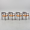A set of four black stained beech tree arm chairs with leather upholstery, second half of the 20th century.
