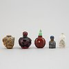 Five chinese snuff bottles of different materials including stone and glass, 20th century.