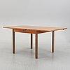 A contemporary walnut veneered dining table.