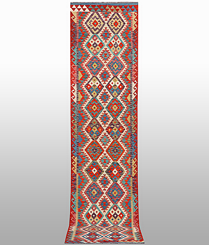 A runner, kilim, ca 395 x 78 cm.