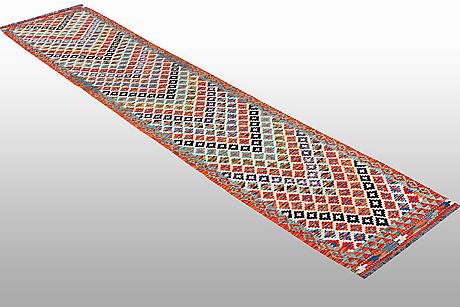 A runner, kilim, ca 400 x 79 cm.