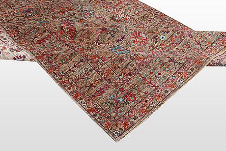A rug, zeigler design, ca  246 x 180 cm.