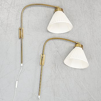 A pair of brass wall lamps, model 2484, designed by Josef FranK, Firma Svenskt Tenn.
