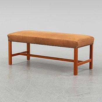 A cherrywood bench, model 2028, designed by Josef Frank in 1950, Firma Svenskt Tenn.