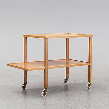 A walnut drink cart designed by Josef Frank for Firma Svenskt Tenn.
