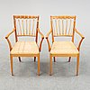 A pair of mahogany armchairs, model 1165, designed by josef frank in 1946 for firma svenskt tenn.