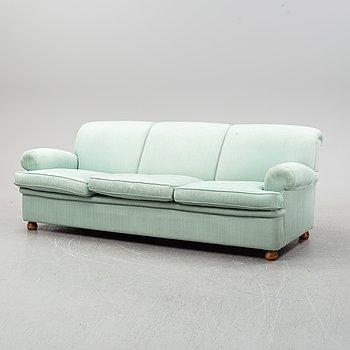A model 703 sofa by Josef Frank for Firma Svenskt Tenn.