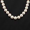 Cultured pearl neckace, clasp 18k white gold with brilliant cut diamonds.