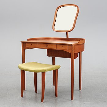 A mahogany veneered dressing table and a stool by Carl Malmsten for Bodafors, second half of the 20th Century.